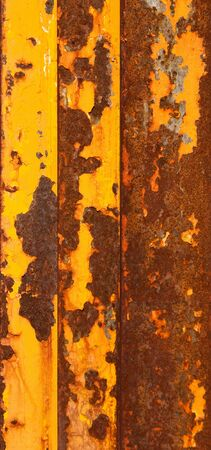 peeled off: Rusty metallic planks with a peeled off yellow paint
