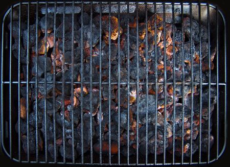 charcoal grill: Coals burning ready for the barbecue