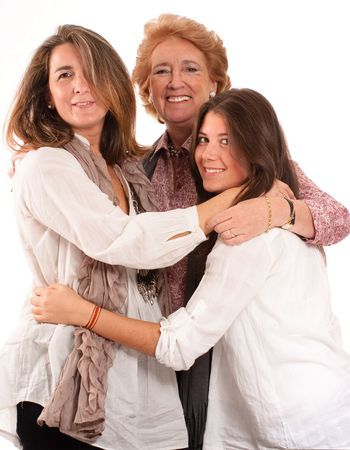 Portrait of Three generations of women of the same family isolated in white  photo