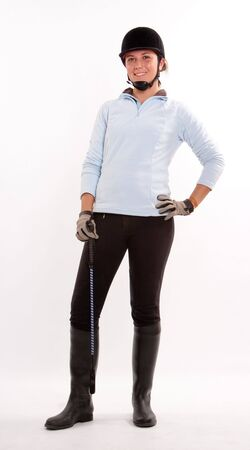 horse riding:  Isolated image of a teenage girl dressed in horse riding clothes  Stock Photo