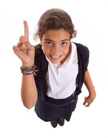 Schoolgirl in uniform raising her finger volunteering Stock Photo - 6368370