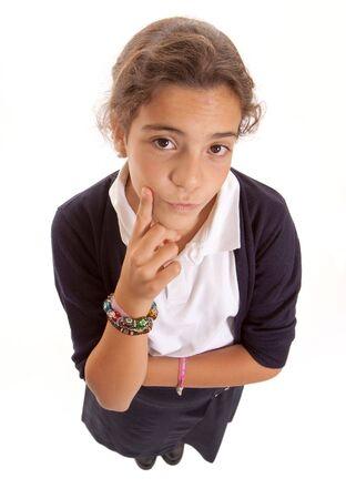 dudando: Colegiala en uniforme vacila en un gesto dudoso Foto de archivo