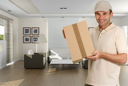 Messenger holding a cardboard box in a home interior