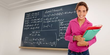 Portrait of a young schoolgirl with a blackboard with formulae as background  Stock Photo - 6410131