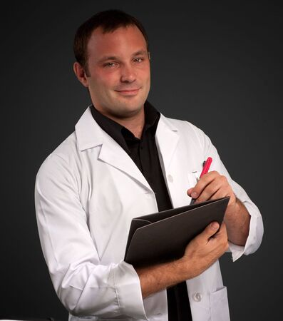 Young man with a medical uniform taking notes Stock Photo - 6410104