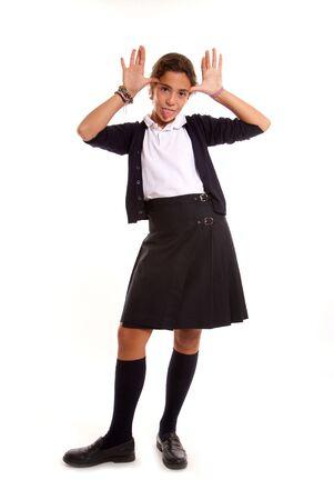 Schoolgirl in uniform in a mocking gesture photo