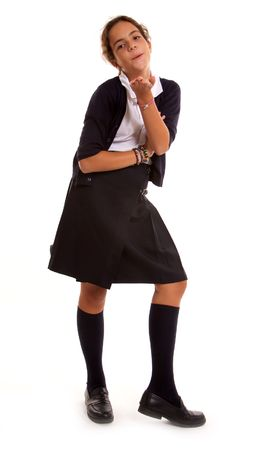Schoolgirl in uniform blowing a kiss photo