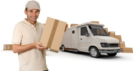 Messenger with a parcel in his hands with a van and piles of packages in the background (I made up the information on the labels so no copyright issue)  photo