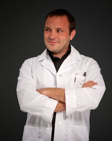 Young man with a medical uniform and a friendly smile Stock Photo - 6453459