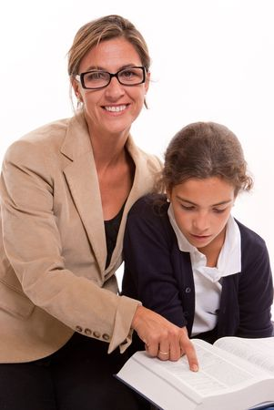 Woman teaching a young schoolgirl isolated on white photo