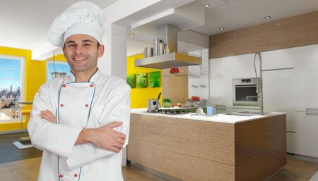 countertop:  Smiling chef in a modern yellow kitchen   Stock Photo