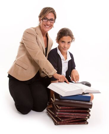 Teacher and pupil and a pile of books photo