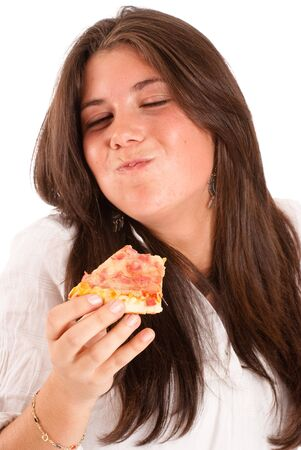 Isolated image of a young girl eating a piece of pizza with relish  photo