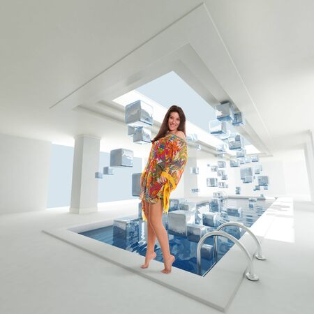 poolside:  Young woman in a Luxurious Indoors swimming pool with ice particles floating in mid-air