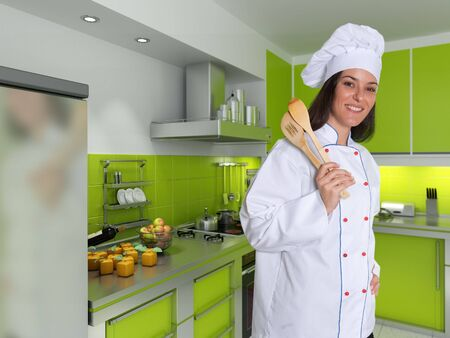 countertop:  Smiling female chef in a modern green kitchen