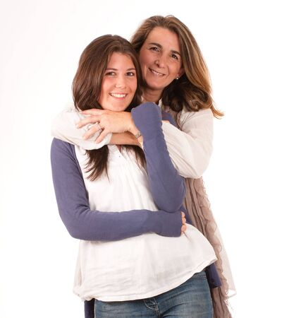parent and teenager:  Isolated image of a mother and a daughter in a happy embrace
