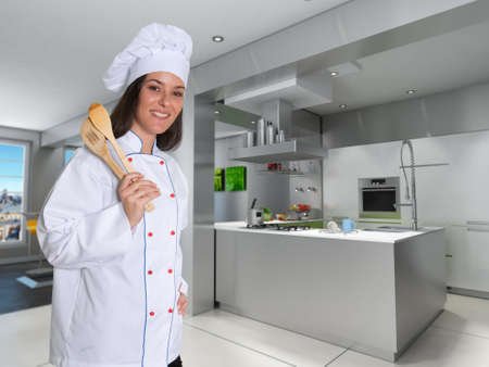countertop:   Smiling female chef in a modern kitchen with cooking tools