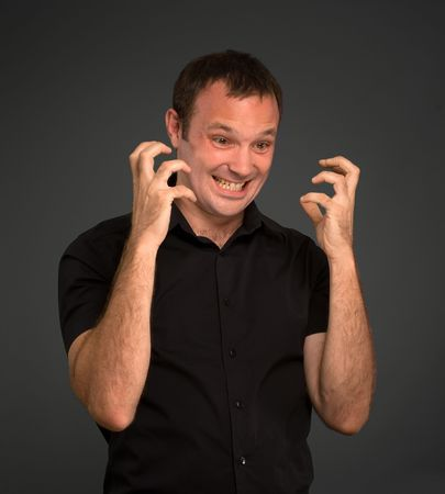 Portrait of a man in black in angry gesture Stock Photo - 6661754
