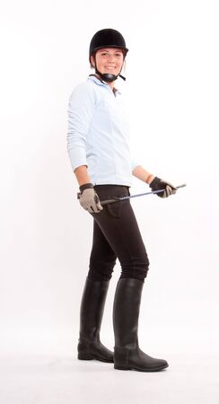 Isolated image of a teenage girl dressed in horse riding clothes Stock Photo - 6677189