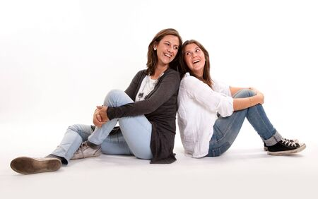 Mother and teen daughter looking at each sharing a joke  photo