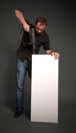 Man drilling and a vertical white board Stock Photo - 6768451