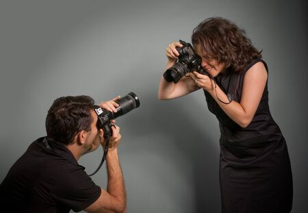 Couple taking pictures of each other  photo