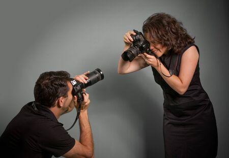 reportero:  Par tomar fotograf�as de cada uno de los otros  Foto de archivo