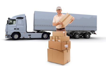 Isolated image of a messenger delivering a lot of boxes with a trailer truck in the background  photo