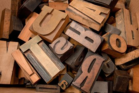 letter case:   Cardboard box with lots of wooden typescript letters
