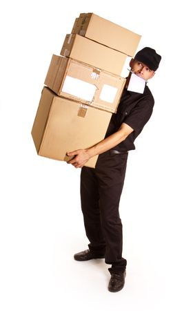Isolated image of a messenger delivering a lot of boxes with a block and pen in his mouth  photo
