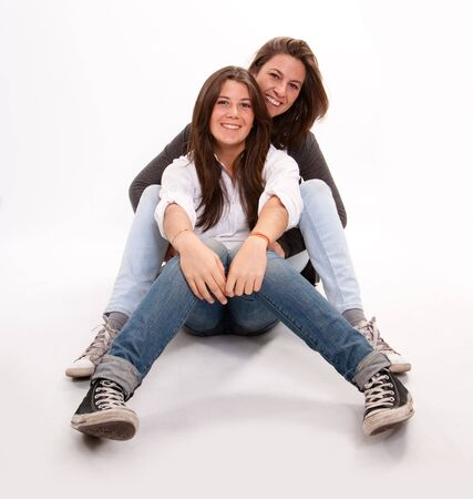 Isolated image of a mother and daughter in laughing together   photo
