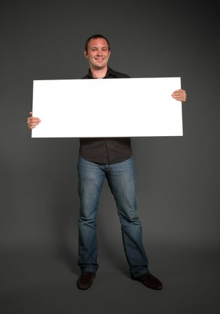 message board:  Cheerful man holding blank message board