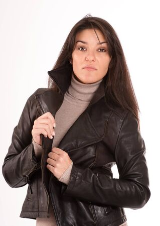 turtleneck:  Isolated portrait of a brunette in a leather jacket   Stock Photo