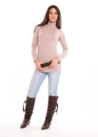 turtleneck:  Fashionable brunette in jeans and high boots  Stock Photo