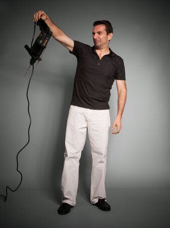 hand drill:  Man looking horrified at a hand drill