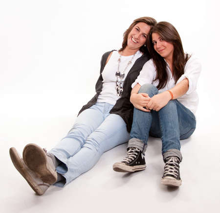 Isolated image of a mother and daughter happily together sitting on the floor  photo
