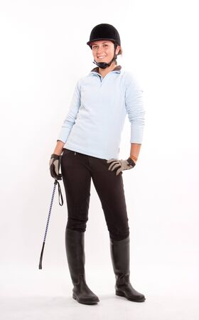 breeches:  Isolated image of a teenage girl dressed in horse riding clothes  Stock Photo