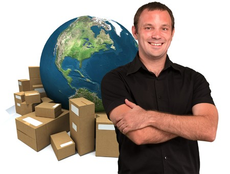 courier:  Smiling man with a world map and lots of cardboard boxes in the background