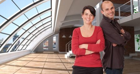 Smiling man and woman in a luxurious empty loft  Stock Photo - 7153827