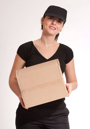 Portrait of a delivery girl in black carrying a parcel  Stock Photo - 7153825