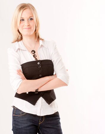 Cute young blond girl with a shirt and a vest  photo