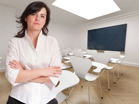 Young teacher in an empty classroom   photo