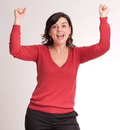exultant:   Portrait very happy brunette celebrating good news  Stock Photo