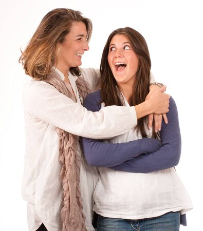 joking:  Isolated image of a Mother and a daughter joking together  Stock Photo