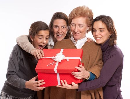 Family women in raptures over an open giftbox photo