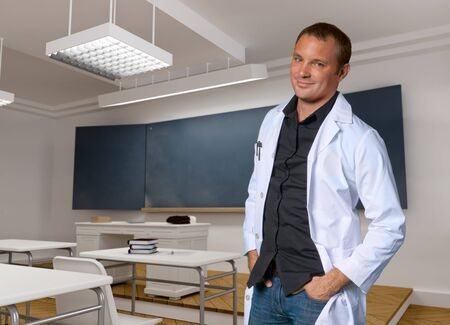 robe:  Portrait of a young man with a white robe in a classroom   Stock Photo