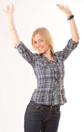 Portrait of a cute blond girl with her arms raised