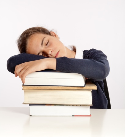 Schoolgirl sleeping on a pile of books  Stock Photo - 9548890