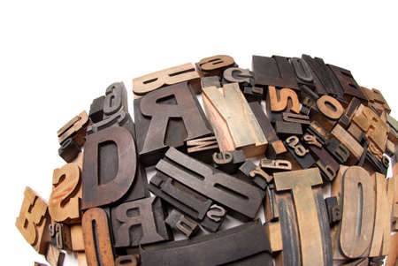 typescript:   Wooden typescript letters against a white background