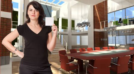 Woman presenting a blank sign in a luxurious modern office interior   photo